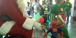 "Santa gives a stuff for ""one stuffed animal toy per orphaned child"" program on Christmas"