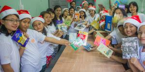 Children are happy with donated books