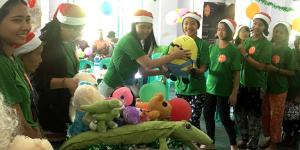"""Giving stuffs to children for """"one stuffed animal toy per orphaned child"""" program on Christmas"""